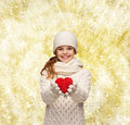 Dreaming girl in winter clothes with red heart Royalty Free Stock Photo