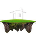Dreaming home on floating green land for real estate theme Stock Photography