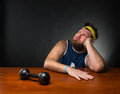 Dreaming man and a dumbbell Royalty Free Stock Photo