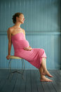 Dreaming pregnant woman delicate portrait of beautiful young glowing in her pregnancy and tenderly about her baby Royalty Free Stock Photo