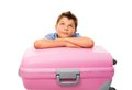 Dreaming about vacation boy laying on suitcase ready to go travel on Stock Images
