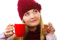 Dreaming woman in woolen cap and shawl with gingerbread cookies and tea white background christmas time decorated or red cup of Royalty Free Stock Photo