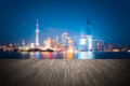 Dreamlike city background of shanghai skyline cityscape at night with wooden floor as a prospect Royalty Free Stock Photography
