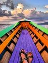 Dreamlike image of female feet in a rowing boat on Inle Lake, Myanmar