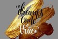 Dreams come true - hand lettering positive quote on golden brush Royalty Free Stock Photo
