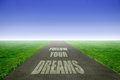 Dreams open road with follow your text Stock Images