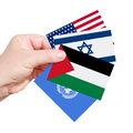 Dreams of the peace hand holding cards with a different national flags united states america israel palestine and united nations Stock Image