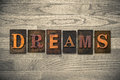 Dreams wooden letterpress theme the word written in vintage ink stained type on a wood grained background Royalty Free Stock Images
