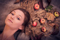 Dreamy autumn girl with leaves and fruits in her hair portrait of beautiful apples gorgeous golden lying over canvas material Royalty Free Stock Image
