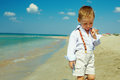 Dreamy baby boy walking the sea beach Stock Photo