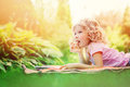 Dreamy child girl reading book in summer garden Royalty Free Stock Photo