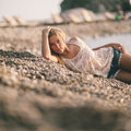 Dreamy girl relax on beach  in fashion jeans shirts Royalty Free Stock Photo