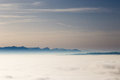 Dreamy horizon looking across the clouds at distant mountains Stock Image