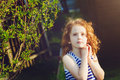 Dreamy little girl in the spring park, Royalty Free Stock Photo