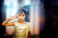 Dreamy portrait of small little girl saluting Royalty Free Stock Photo