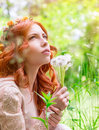 Dreamy woman with dandelions Stock Images