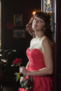 Dreamy woman in red with the rose Royalty Free Stock Image