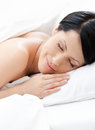 Dreamy woman sleeps in bed Royalty Free Stock Photography