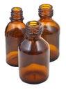Drei kleine offene braune ovale apothekenglasflaschen Stockbilder