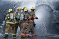 Drenched Firefighters Royalty Free Stock Photos