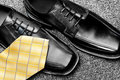 Dress shoes and necktie Royalty Free Stock Photos
