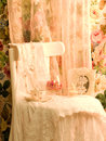 Dress, teacup and frame on white chair