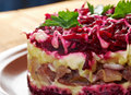 Dressed herring russian salad traditional with salted and beet selyodka pod shuboy Royalty Free Stock Photography