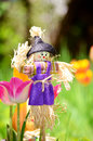 Dressed  scarecrow for decoration in a green spring  garden Royalty Free Stock Photo