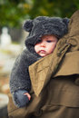 Dressed for winter cute baby in a bear suit Stock Photography