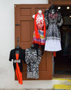 Dresses on wooden door colorful hanging display a Stock Photography