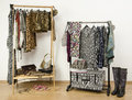 Dressing closet with animal print clothes arranged on hangers colorful wardrobe jungle pattern and accessories Stock Photo
