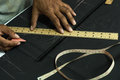 Dressmaker s hands are made ​​to measure cut clothes Royalty Free Stock Photos