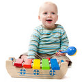 Dribbling Baby Boy Playing with Xylophone Royalty Free Stock Photo