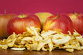 Dried apple slices ​​on a table with the fresh apples on the background Stock Image