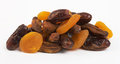 Dried apricots, dates and bananas on white Stock Image
