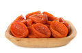 Dried apricots in wooden bowl isolated on white background Stock Images