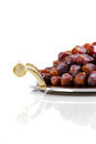 Dried arabic dates presented on an ornate tra tray and shot against a white background Stock Photography
