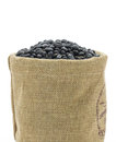 Dried black beans in sacks fodder close up on white background Stock Photography