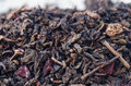 Dried black tea leaves and fruits Royalty Free Stock Photo