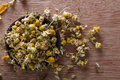 Dried chamomile buds for tea alternative medicine pot pourri copy space Stock Photo