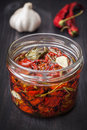Dried cherry tomatoes with herbs and spices. Italian cuisine. Stock Image