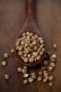 Dried coriander in a wooden spoon close up selective focus vertical Stock Photo