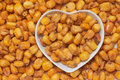 Dried corn snack in heart shaped tray Stock Photo