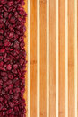 Dried cranberries lying on a bamboo mat as background Royalty Free Stock Photography