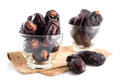 Dried dates fruit pile of fresh date fruits in glass isolated on white background Stock Photo