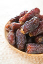 Dried dates fruit pile of fresh date fruits in a wooden plate Royalty Free Stock Photography