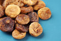 Dried figs on blue plate heap of Royalty Free Stock Images
