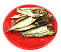 Dried fish on red plate isolated white Royalty Free Stock Photo