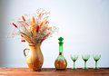 Dried flowers in a ceramic vase and glass cups Stock Images