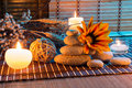 Dried flowers, white stones, candles on bamboo mat Royalty Free Stock Photo